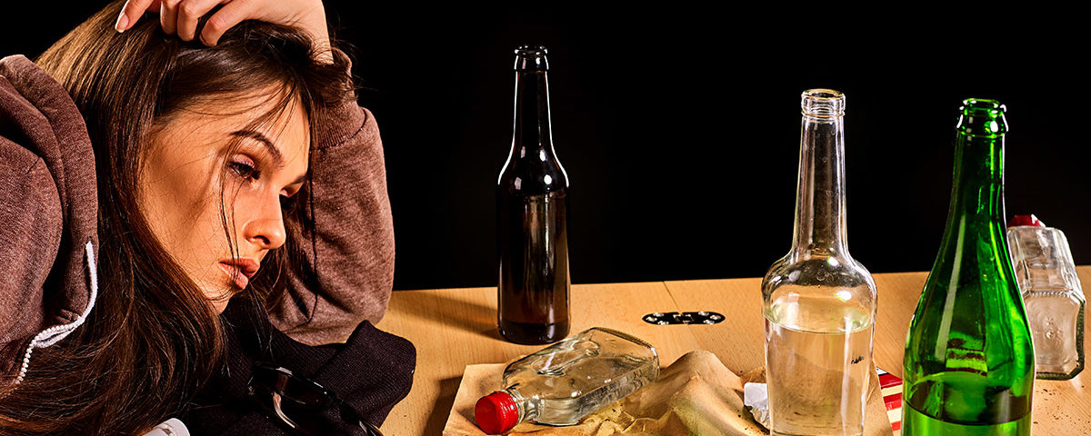 woman showing signs addicted to alcohol