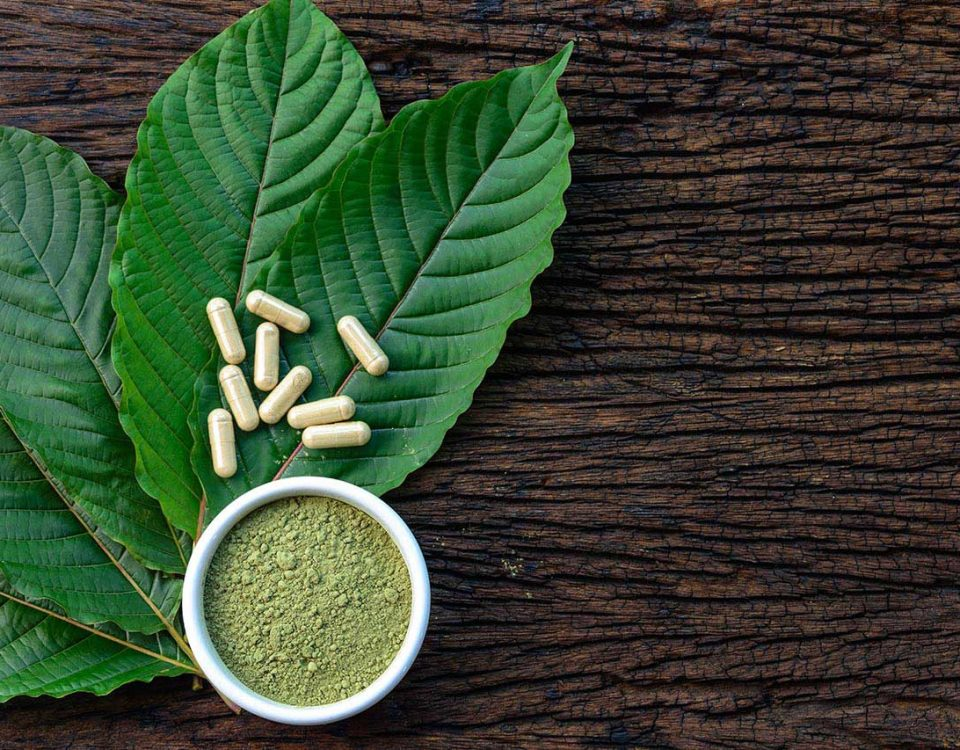 Kratom pills on leaves